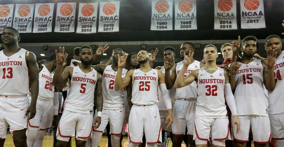 Houston Cougars sing the school's fight song after defeating Connecticut Huskies 81-71  at H&PE Arena at TSU on Sunday, March 4, 2018, in Houston. ( Elizabeth Conley / Houston Chronicle ) Photo: Elizabeth Conley/Houston Chronicle