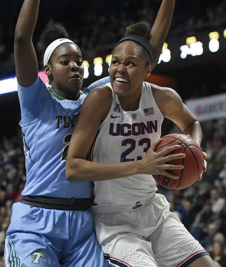 UConn's Azurá Stevens, right, looks to shoot as Tulane's Harlyn Wyatt defends Sunday in Uncasville. Photo: Jessica Hill / Associated Press / AP2018