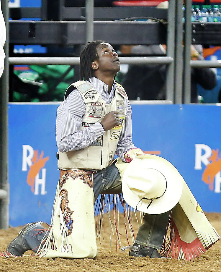 Neil Holmes gives thanks after riding Wildcat during Super Series II Round 3 Bull Riding action at Rodeo Houston Sunday, March 4, 2018, in Houston. ( Steve Gonzales / Houston Chronicle ) Photo: Steve Gonzales/Houston Chronicle