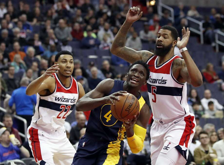 Pacers guard Victor Oladipo drives between Washington forwards Otto Porter Jr. (left) and Markieff Morris. Photo: Alex Brandon, Associated Press