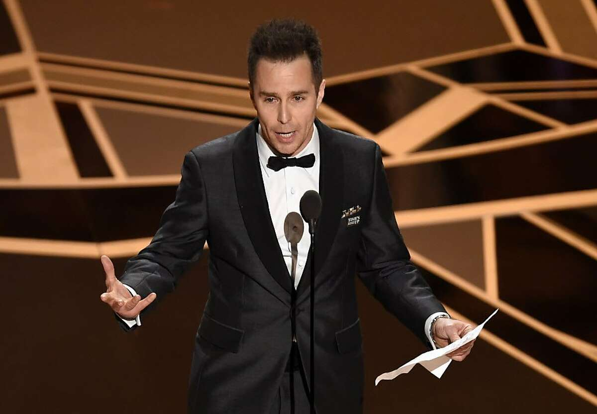"""Sam Rockwell accepts the award for best performance by an actor in a supporting role for """"Three Billboards Outside Ebbing, Missouri"""" at the Oscars on Sunday, March 4, 2018, at the Dolby Theatre in Los Angeles. (Photo by Chris Pizzello/Invision/AP)"""