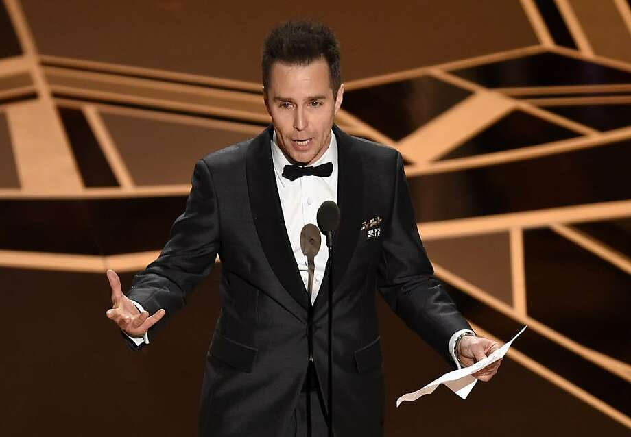 "Sam Rockwell accepts the award for best performance by an actor in a supporting role for ""Three Billboards Outside Ebbing, Missouri"" at the Oscars on Sunday, March 4, 2018, at the Dolby Theatre in Los Angeles. (Photo by Chris Pizzello/Invision/AP) Photo: Chris Pizzello, Associated Press"