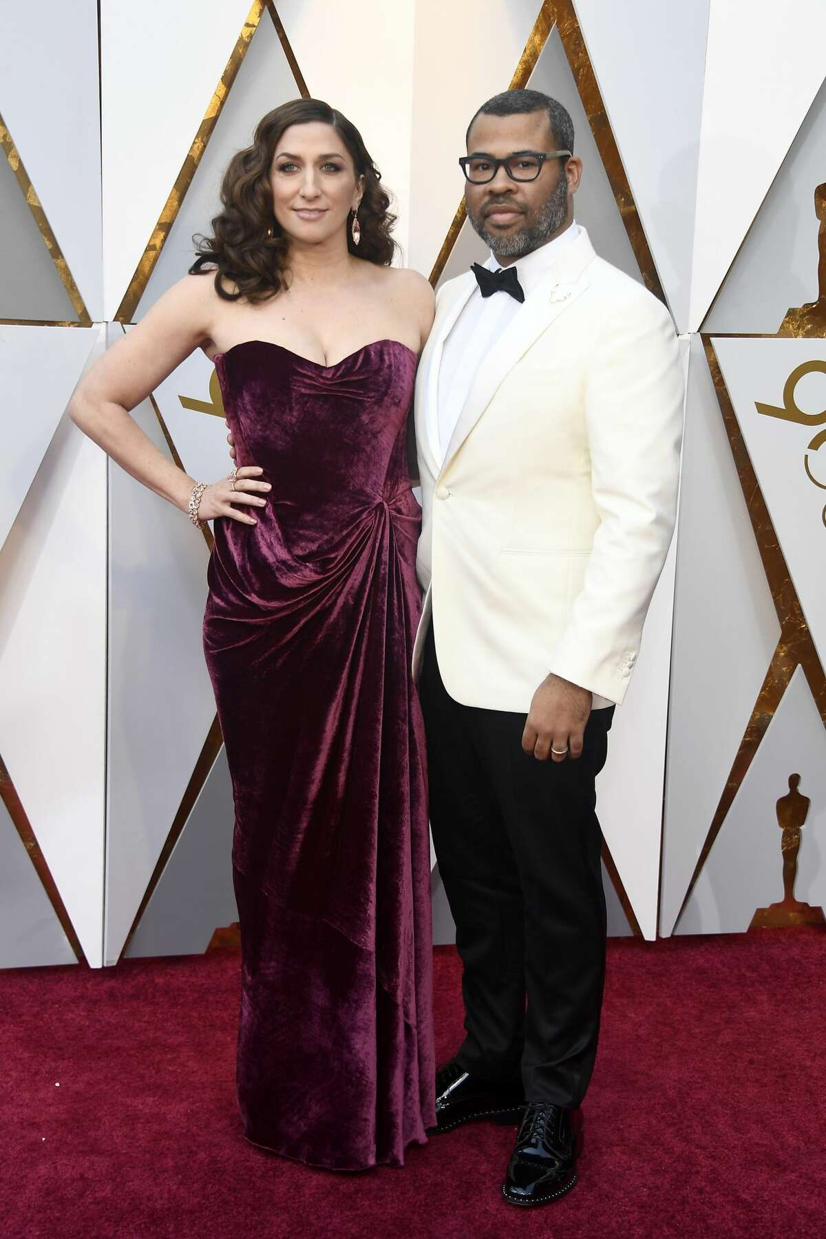 Chelsea Peretti (L) and husband Jordan Peele attend the 90th Annual Academy Awards at Hollywood & Highland Center on March 4, 2018.