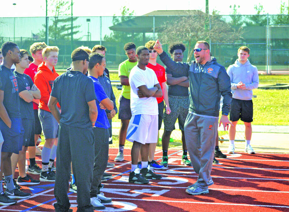 Edwardsville boys' track and field coach Chad Lakatos, right, talks to his team last Tuesday at the start of practice.
