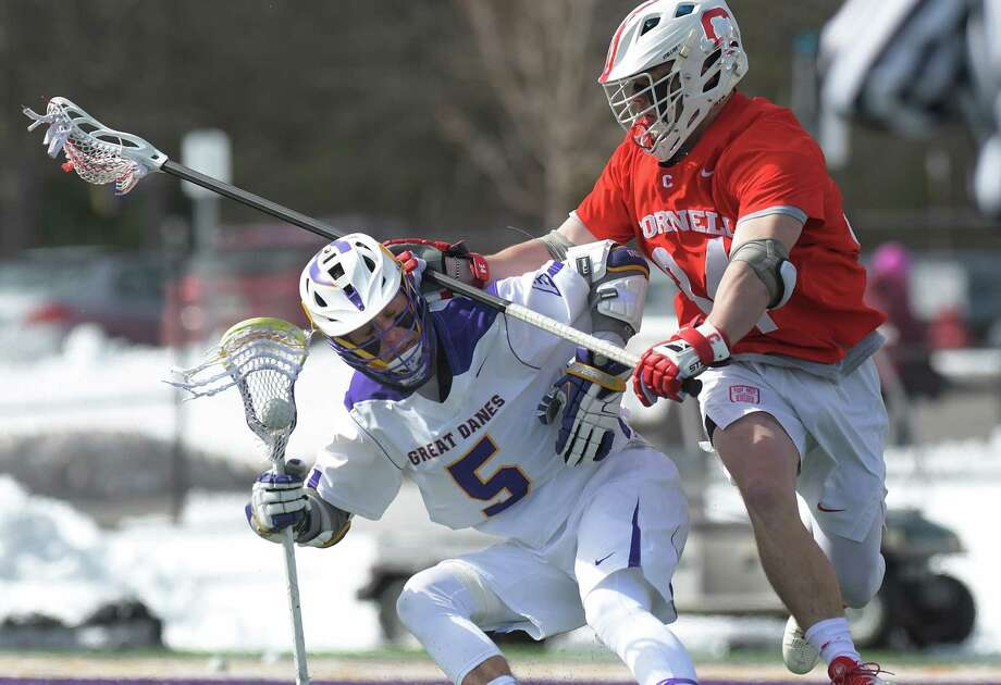 Connor Fields of Albany tries to get around Jake Pulver of Cornell during their game on Sunday, March 4, 2018, in Albany, N.Y.   (Paul Buckowski/Times Union) Photo: PAUL BUCKOWSKI / (Paul Buckowski/Times Union)