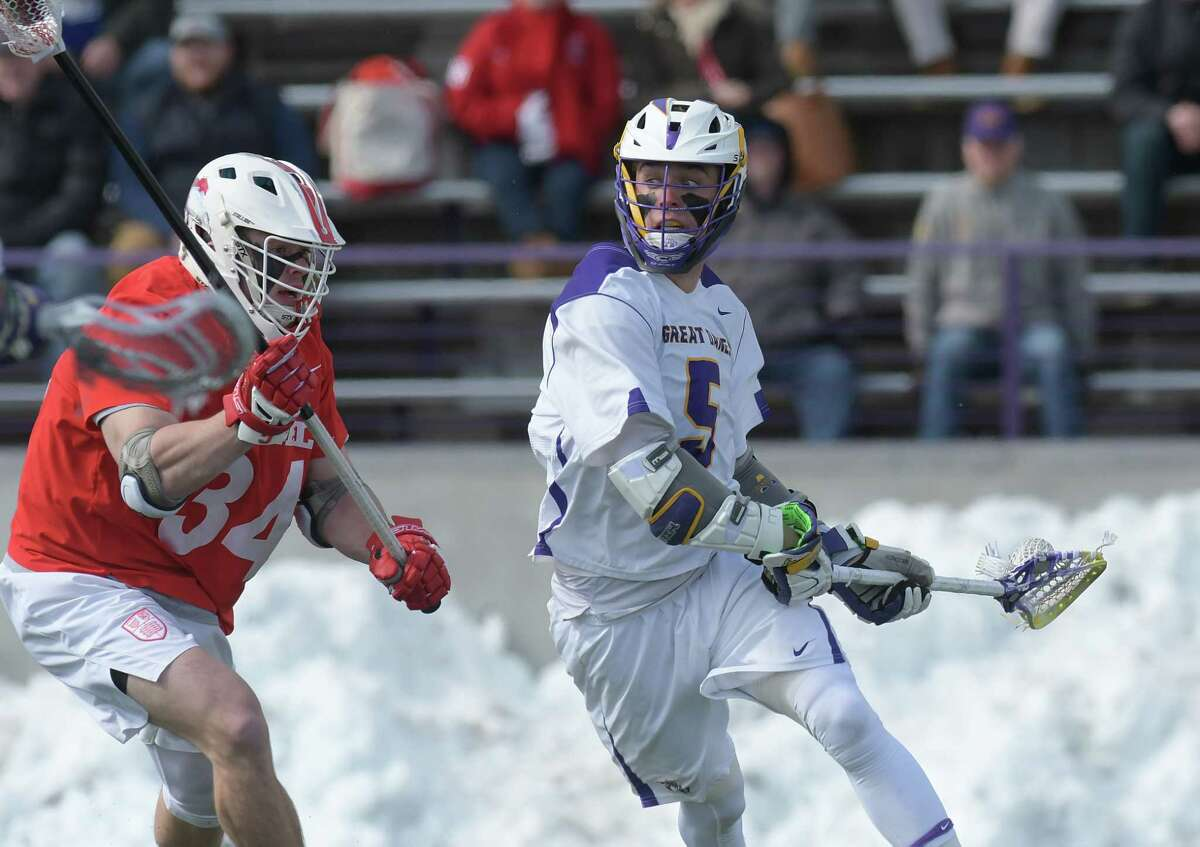Jake Pulver of Cornell, left, tries to stop the shot of Connor Fields of Albany during their game on Sunday, March 4, 2018, in Albany, N.Y. (Paul Buckowski/Times Union)