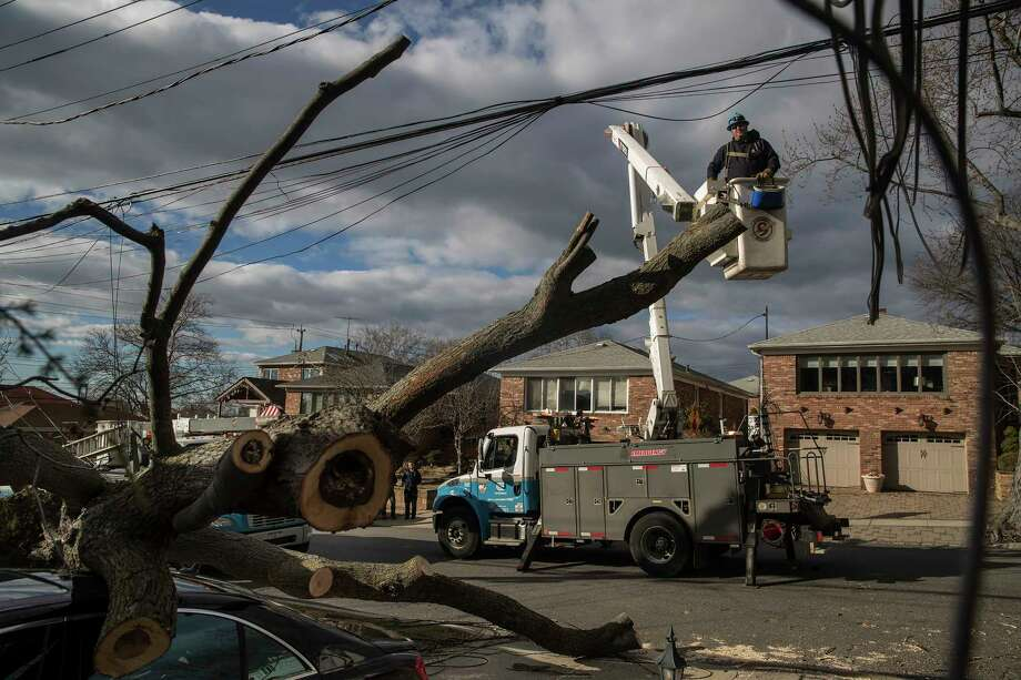 A Con Edison crew workS to restore power in the Queens neighborhood of Whitestone, in New York, March 4, 2018. Hundreds of thousands of people remained without electricity on Sunday, after a fierce storm swept through much of the eastern U.S, on Friday. (Victor J. Blue/The New York Times) Photo: VICTOR J. BLUE / NYTNS