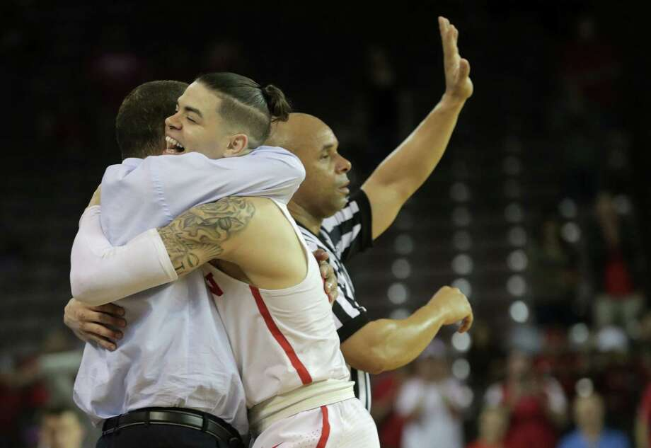 Senior guard Rob Gray, right, earned a hug from UH coach Kelvin Sampson after tying Sunday's game at 63, then reeling off the Cougars' next nine points as they pulled away. Photo: Elizabeth Conley, Chronicle / © 2018 Houston Chronicle