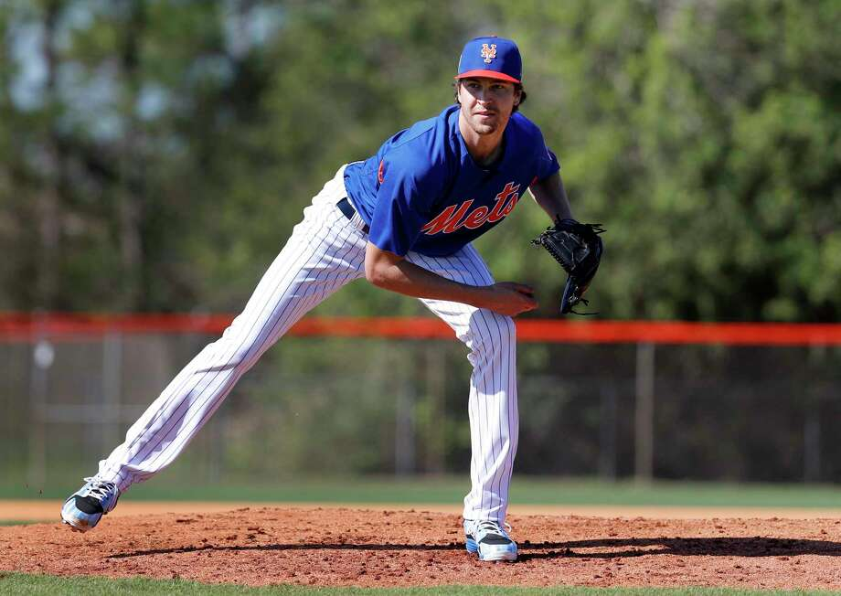 New York Mets pitcher Jacob deGrom takes part in a drill during spring training baseball practice Friday, Feb. 16, 2018, in Port St. Lucie, Fla. (AP Photo/Jeff Roberson) Photo: Jeff Roberson / Copyright 2018 The Associated Press. All rights reserved.