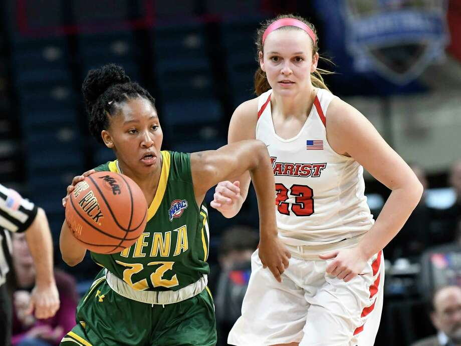 Siena guard Deja Rawls (22) moves the ball past Marist guard Rebekah Hand (23) during the first half of an NCAA college basketball game in the semifinal of the Metro Atlantic Athletic Conference tournament Monday, March 5, 2018, at the Times Union Center in Albany, N.Y. Marist won the game 67-51. (AP Photo/Hans Pennink) Photo: Hans Pennink / Hans Pennink