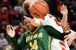 Siena guard Joella Gibson (14) and Marist guard Rebekah Hand (23) chase a rebound during the first half of an NCAA college basketball game in the semifinal of the Metro Atlantic Athletic Conference tournament Monday, March 5, 2018, at the Times Union Center in Albany, N.Y. Marist won the game 67-51. (AP Photo/Hans Pennink)