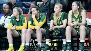 Siena Players react to a 67-51 loss to Marist during an NCAA college basketball game in the semifinal of the Metro Atlantic Athletic Conference tournament Monday, March 5, 2018, at the Times Union Center in Albany, N.Y. (AP Photo/Hans Pennink)