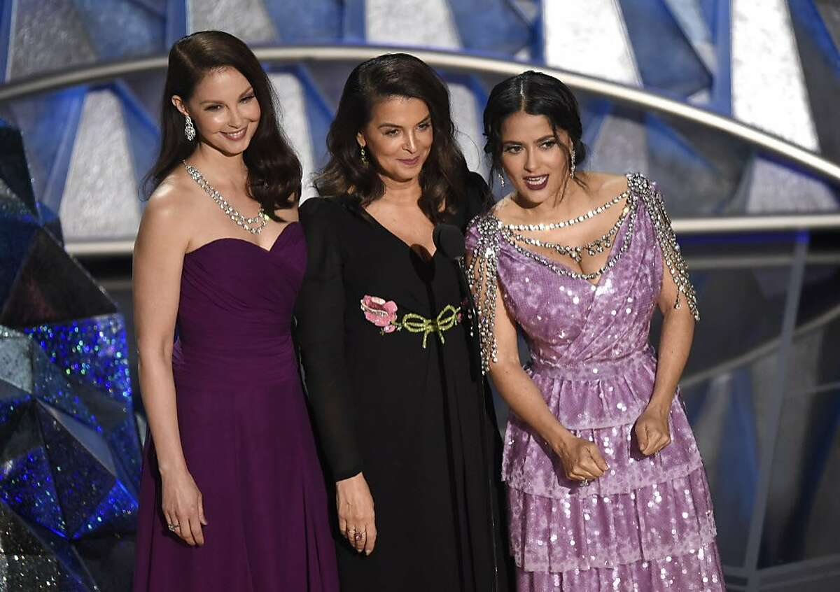 Ashley Judd, from left, Annabella Sciorra and Salma Hayek speak at the Oscars on Sunday, March 4, 2018, at the Dolby Theatre in Los Angeles.