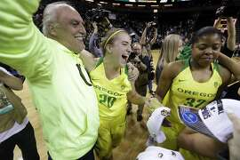 Oregon's Sabrina Ionescu (20) celebrates with her dad, Dan Ionescu, after the team beat Stanford in an NCAA college basketball game in the finals of the Pac-12 Conference women's tournament, Sunday, March 4, 2018, in Seattle. Oregon won 77-57. (AP Photo/Elaine Thompson)