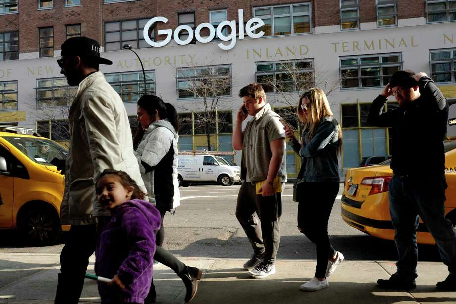 FILE - In this Dec. 4, 2017, file photo, people walk by the the Google office building on Ninth Avenue in New York. Google has been quietly expanding its footprint in the city and is reportedly close to reaching a $2.4 billion deal to add the landmark Chelsea Market building in the Meatpacking District to its already substantial New York campus. It's the latest example of a big-name tech firm expanding in New York City, which has, for years, been trying to stake a claim as Silicon Valley East. (AP Photo/Mark Lennihan, File) Photo: Mark Lennihan / Copyright 2017 The Associated Press. All rights reserved.