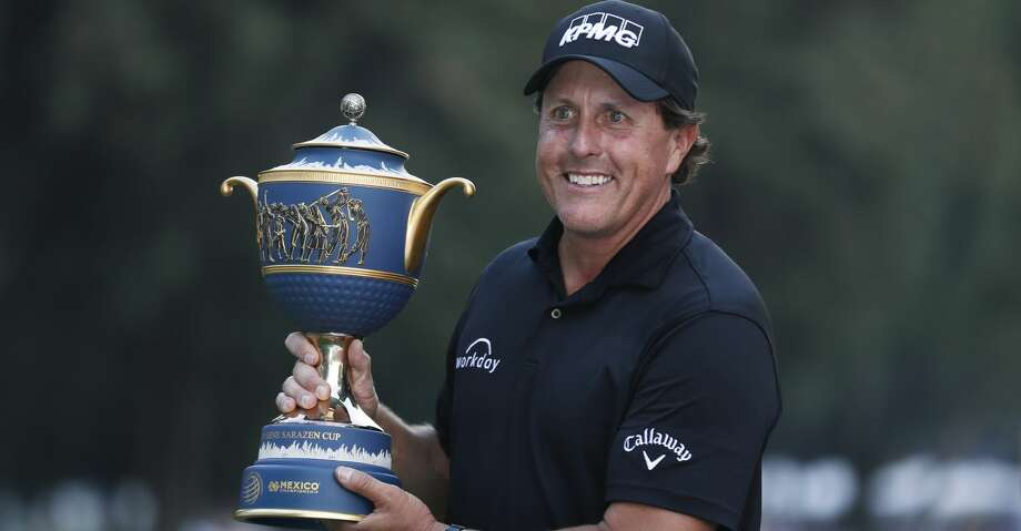 Phil Mickelson, of the U.S., poses with his Mexico Championship trophy at the Chapultepec Golf Club in Mexico City, Sunday, March 4, 2018. (AP Photo/Eduardo Verdugo) Photo: Eduardo Verdugo/Associated Press