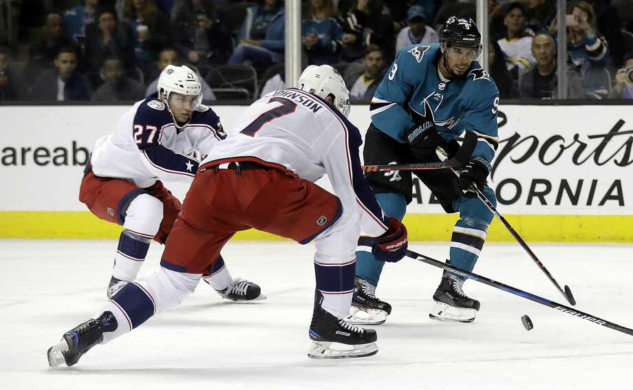 Columbus Blue Jackets' Jack Johnson (7) blocks a shot from San Jose Sharks' Evander Kane, right, during the second period of an NHL hockey game Sunday, March 4, 2018, in San Jose, Calif. (AP Photo/Marcio Jose Sanchez) Photo: Marcio Jose Sanchez, Associated Press