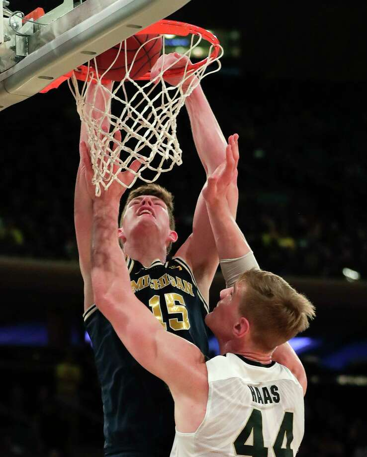 Michigan center Jon Teske (15) dunks the ball against Purdue center Isaac Haas (44) during the second half of the NCAA Big Ten Conference tournament championship college basketball game, Sunday, March 4, 2018, in New York. Michigan won 75-66. (AP Photo/Julie Jacobson) Photo: Julie Jacobson / Copyright 2018 The Associated Press. All rights reserved.