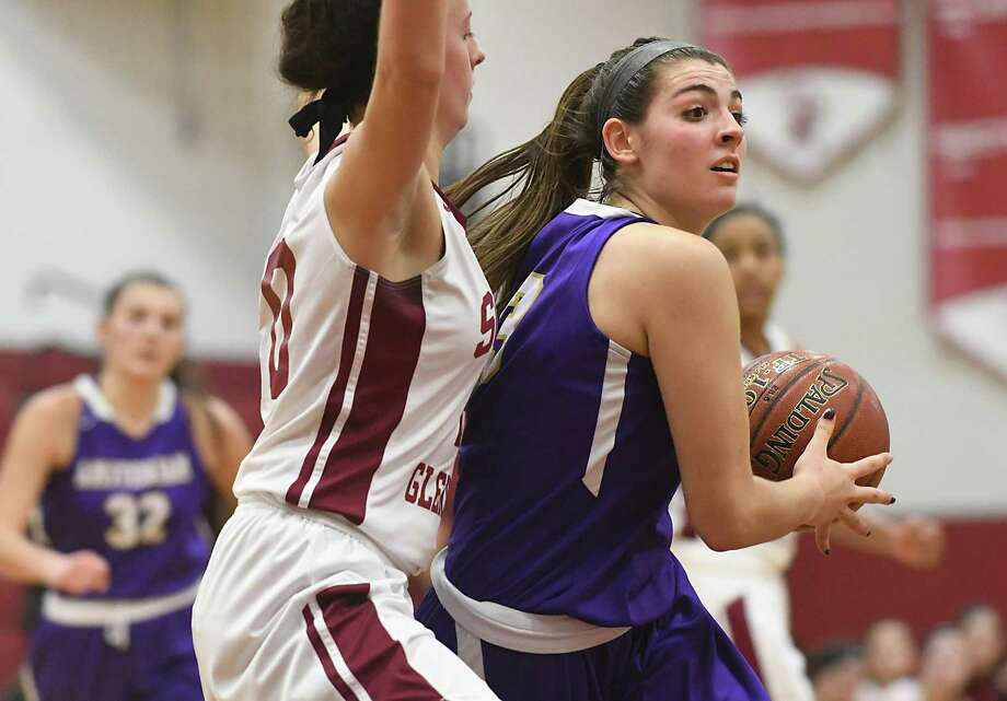 Amsterdam's Giuliana Pritchard, right, drives to the basket guarded by Scotia's Mary Kate Palleschi during a basketball game on Monday, Jan. 22, 2018 in Scotia, N.Y. (Lori Van Buren/Times Union) Photo: Lori Van Buren / 20042711A