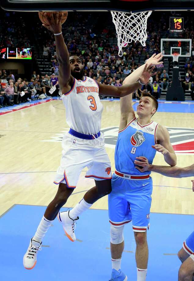 New York Knicks forward Tim Hardaway Jr., left, goes to the basket against Sacramento Kings guard Bogdan Bogdanovic during the first half of an NBA basketball game, Sunday, March 4, 2018, in Sacramento, Calif. (AP Photo/Rich Pedroncelli) Photo: Rich Pedroncelli / Copyright 2018 The Associated Press. All rights reserved.