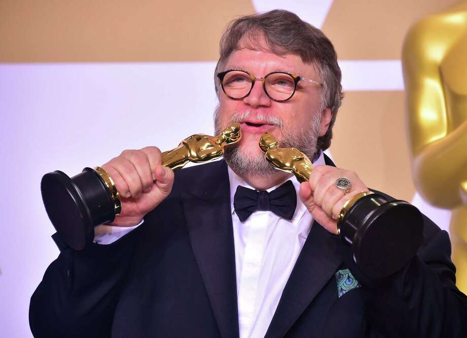 Director Guillermo del Toro poses in the press room with the Oscars for best picture and best director during the 90th Annual Academy Awards on March 4, 2018, in Hollywood, California. Photo: FREDERIC J. BROWN, AFP/Getty Images / AFP or licensors
