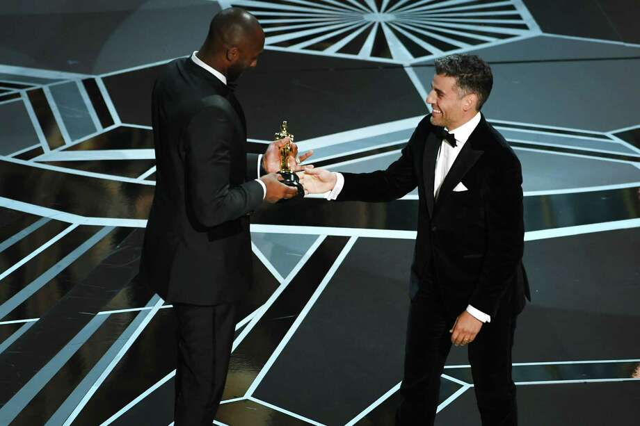 HOLLYWOOD, CA - MARCH 04:  Filmmaker Kobe Bryant (L) accepts Best Animated Short Film for 'Dear Basketball' from actor Oscar Isaac onstage during the 90th Annual Academy Awards at the Dolby Theatre at Hollywood & Highland Center on March 4, 2018 in Hollywood, California.  (Photo by Kevin Winter/Getty Images) Photo: Kevin Winter, Staff / 2018 Getty Images