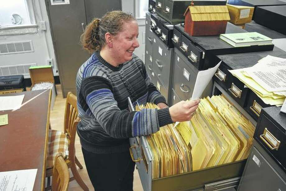 Lynne Phillips, the new archivist for MacMurray College and the Illinois Great Rivers Conference of the United Methodist Church, looks through some files at the archives. Photo: Greg Olson | Journal-Courier