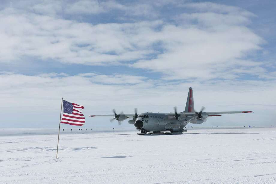 A crew from the 109th Airlift Wing from Scotia lands their C-130 ?Skibird? troops-cargo plane at a base in Antarctica.  (109th Airlift Wing) Photo: Staff Sgt. Benjamin German