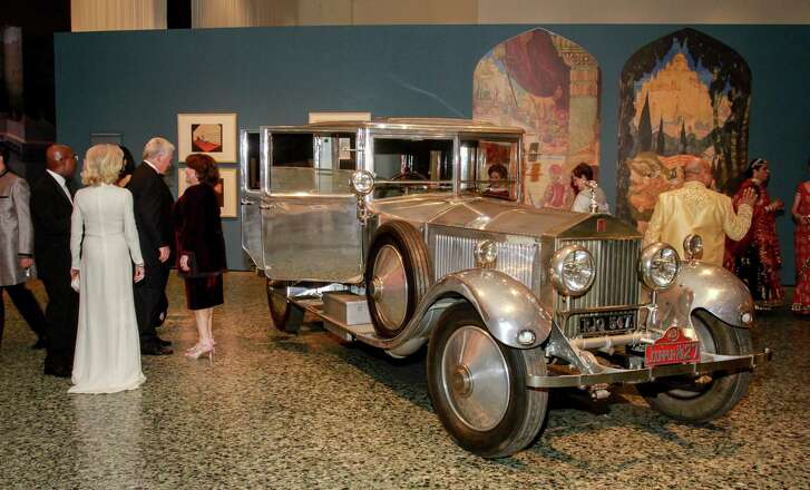 """Guests around the Rolls Royce at the opening dinner for """"Peacock in the Desert: The Royal Arts of Jodhpur, India,"""" at MFAH."""