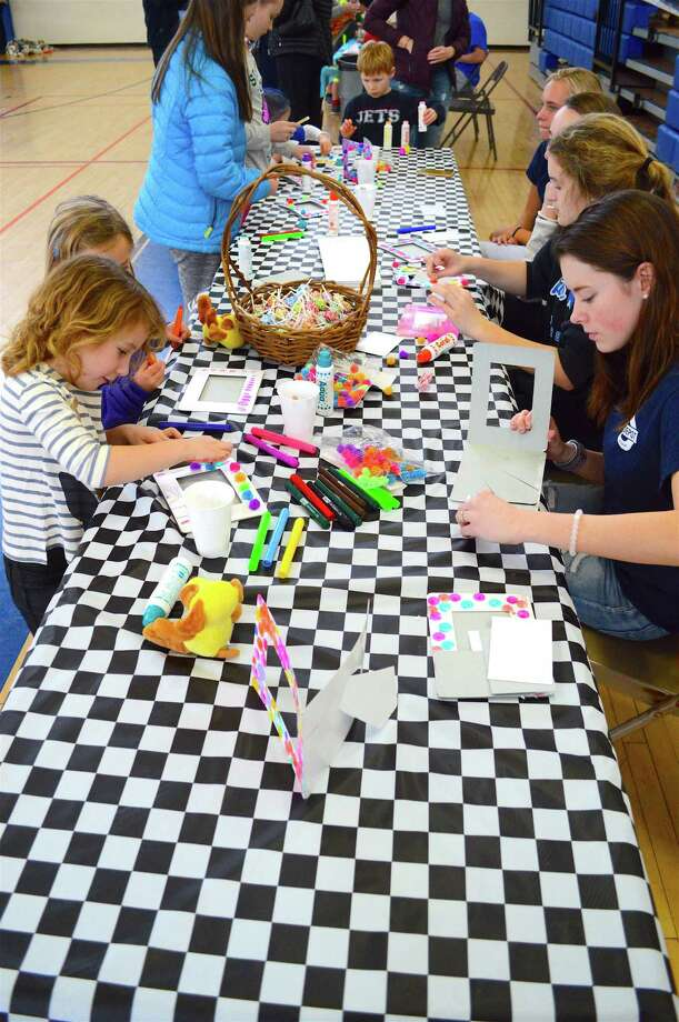 Kids and teen volunteers do some craft work at the Community Art Festival at Town Hall, Saturday, March 3, 2018, in Darien, Conn. Photo: Jarret Liotta / For Hearst Connecticut Media / Darien News Freelance