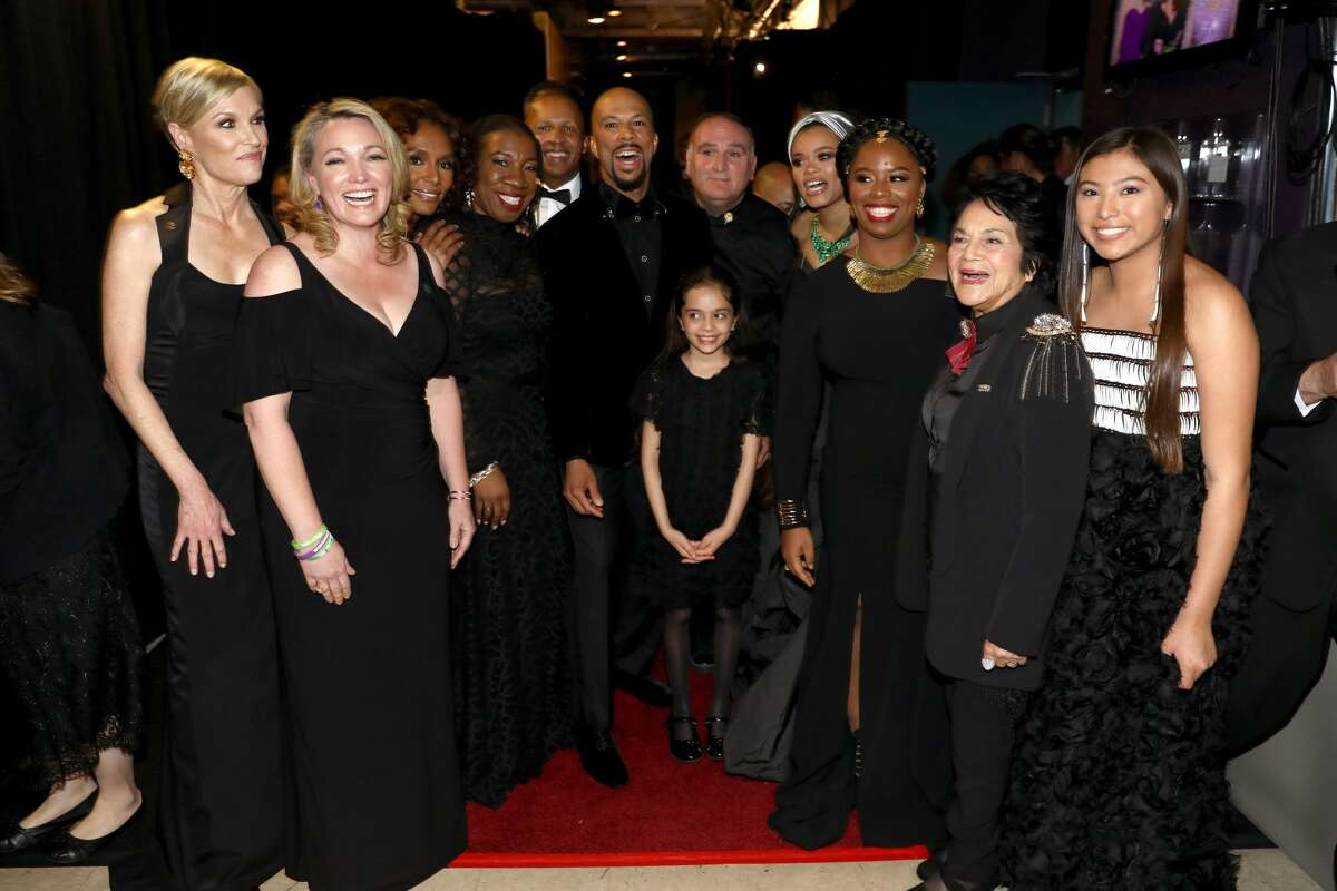 HOLLYWOOD, CA - MARCH 04: In this handout provided by A.M.P.A.S., (L-R) Cecile Richards, Nicole Hockley, Janet Mock, Tarana Burke, Bryan Stevenson, Common, guest, Bana Alabed, Andra Day, Patrisse Cullors, Dolores Huerta and guest attend the 90th Annual Academy Awards at the Dolby Theatre on March 4, 2018 in Hollywood, California. (Photo by Matt Sayles/A.M.P.A.S via Getty Images)
