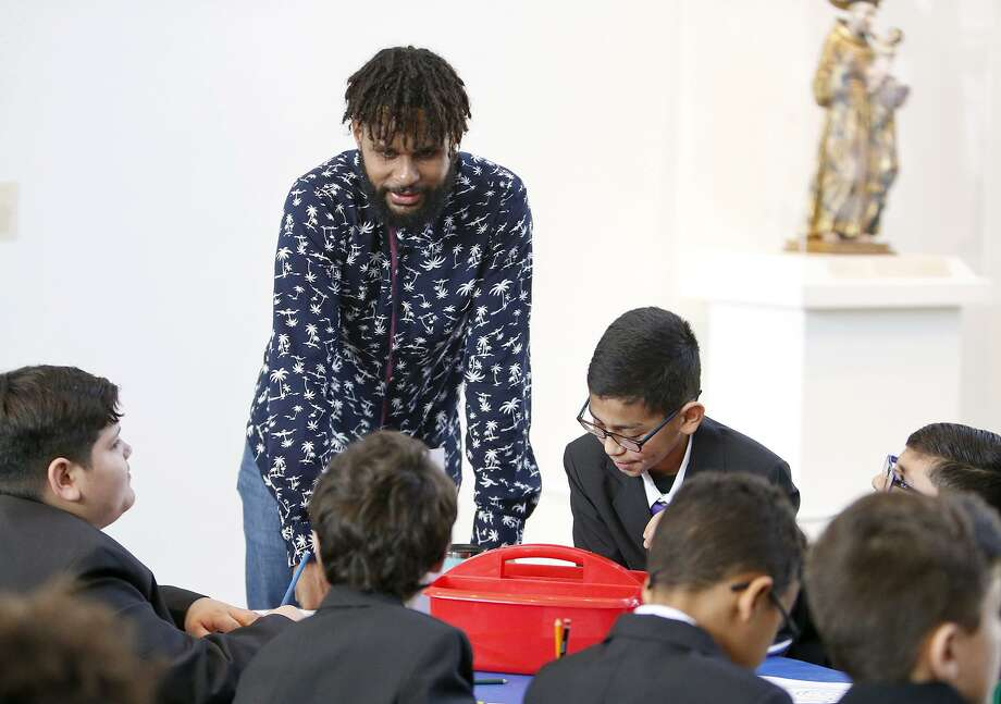 San Antonio Spurs Guard Patty Mills talks with students from the Young Men's Leadership Academy Monday Feb. 26, 2018 at the San Antonio Museum of Art. Photo: Edward A. Ornelas, Staff / San Antonio Express-News / © 2018 San Antonio Express-News