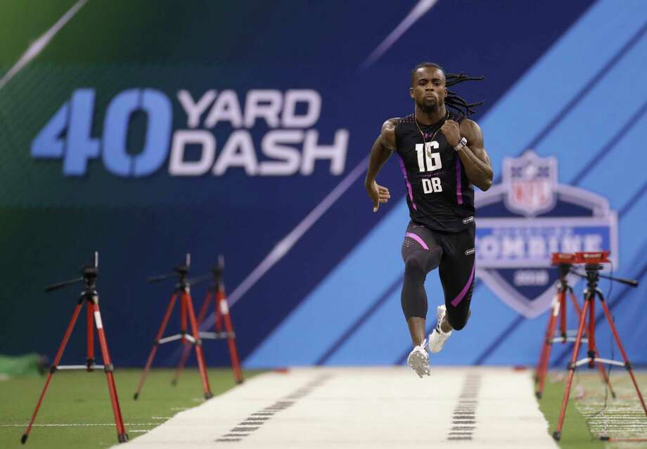 LSU defensive back Donte Jackson runs the 40-yard dash during the NFL football scouting combine, Monday, March 5, 2018, in Indianapolis. (AP Photo/Darron Cummings) Photo: Darron Cummings, Associated Press / Copyright 2018 The Associated Press. All rights reserved.