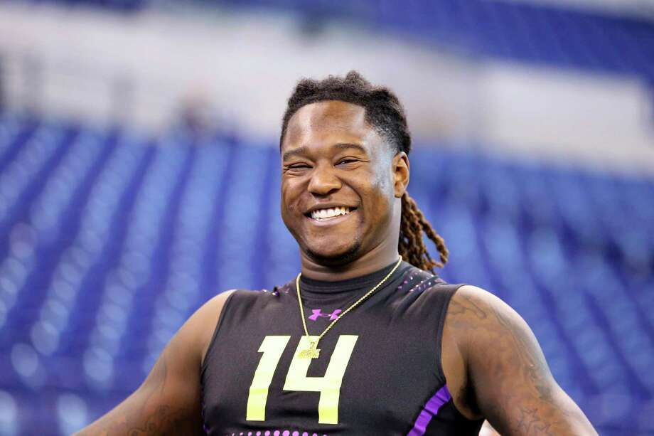 Despite having his right hand amputated when he was 4 years old, UCF linebacker Shaquem Griffin had an impressive college career and now is turning heads at the NFL combine. Photo: Gregory Payan, Associated Press / Copyright 2018 The Associated Press. All rights reserved.