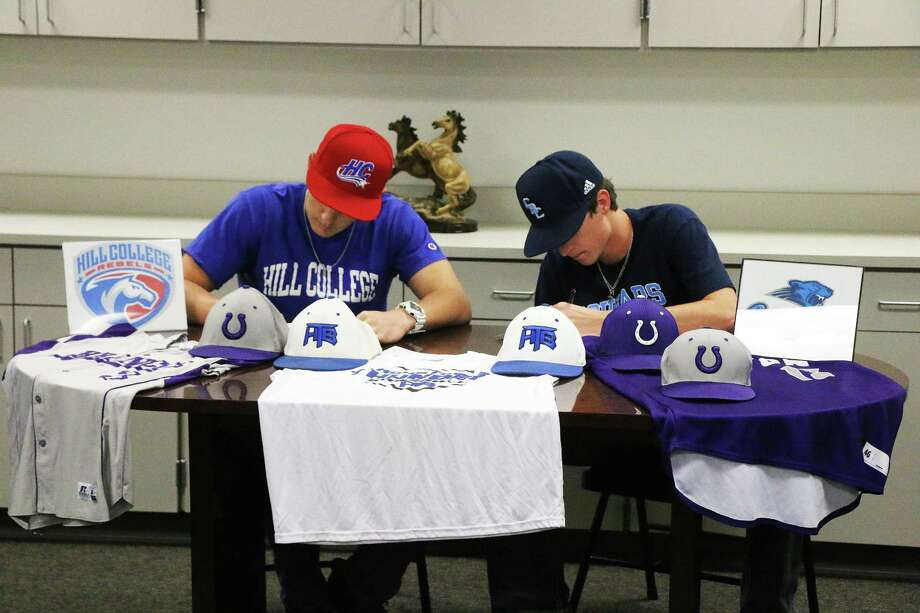 With their heads down as they sign their National Intent Letter to play for their respective colleges, Reese Miller and Nolan Cox hope to use a playoff run as a springboard into their college careers on the diamond. Photo: David Taylor