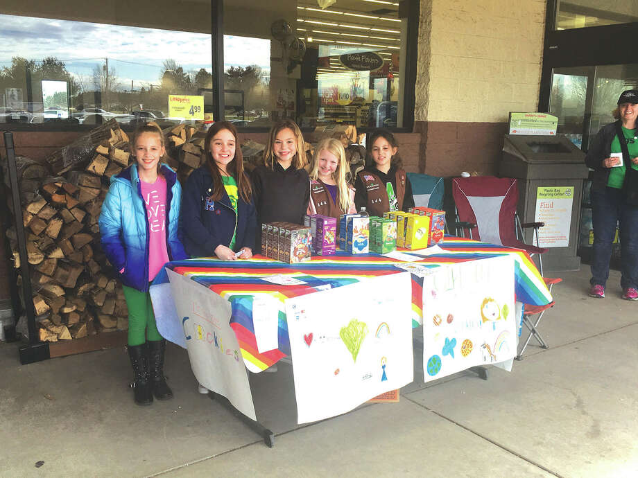 Girl Scouts from Cassens and Columbus elementary schools set up for Cookie Booth Weekend on Sunday in front of the Edwardsville Shop 'n  Save. A second Cookie Booth Weekend is being conducted across the country Friday through Sunday.  Find a local Girl Scout cookie booth by visiting www.girlscoutcookies.org or using the official Girl Scout Cookie Finder app, free for iOS or Android phones or mobile devices. Photo: Bill Tucker • Btucker@edwpub.net