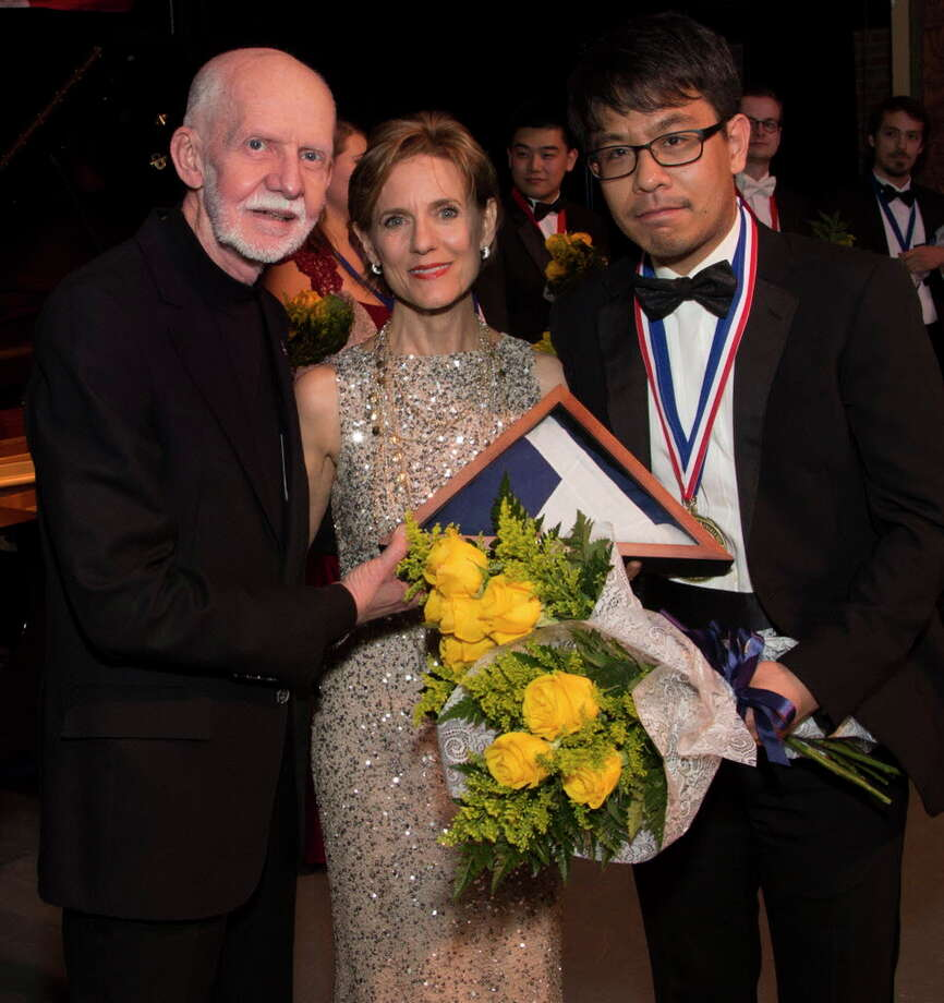 Jim and Susie Pokorski, founder, and chair and executive director of Young Texas Artists Inc., respectively, with Grand Prize winner violinist Douglas Kwon, who took home Gold in the Strings division in 2017. This year's event is set for March 8-10 in downtown Conroe.