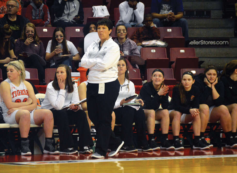 Edwardsville coach Lori Blade paces the sideline during the second half of Saturday's Class 4A third-place game against Des Plaines Maine West inside Redbird Arena in Normal. The Tigers suffered a 45-41 setback, but they added a fourth-place state trophy to the second-place version they picked up last season. Photo: Matt Kamp • Mkamp@edwpub.net