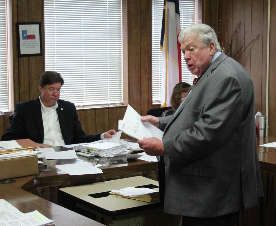 Randy Blanks (right) of Waxman and Associates discusses the bids for the CDBG grant for the San Jacinto County senior centers during the Feb. 28 commissioners court meeting. Photo: Jacob McAdams