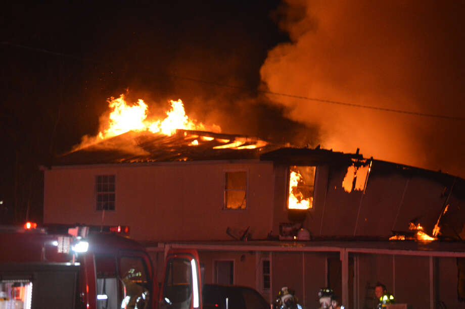 Eighteen people were displaced by a fire in a small apartment building in Mauriceville early Monday morning. Photos provided by Eric Williams.