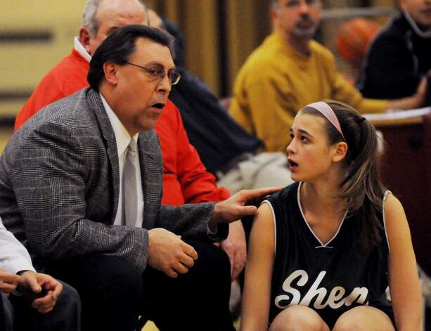 Shenendehowa coach Ken Strube confers with Kayla Wheeler before she enters the game against Colonie.  (Luanne M. Ferris / Times Union) Photo: LMF