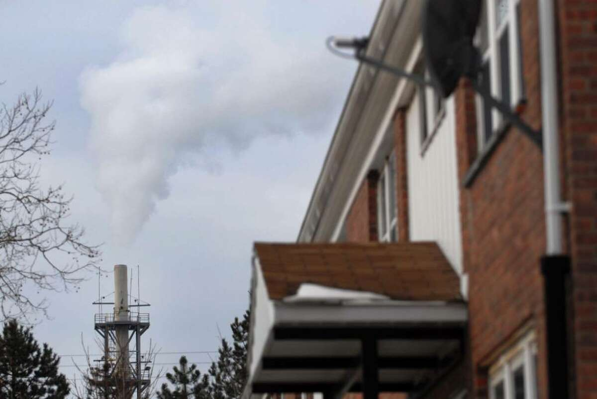 A Norlite stack is near housing authority units in Cohoes. In addition to a $90,000 fine, the polluter will finance a $35,000 environmental project in the city. (Paul Buckowski/Times Union archive)