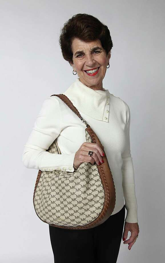 Lynn Stahl and her bag. Photo: Juanito M. Garza /San Antonio Express-News / San Antonio Express-News