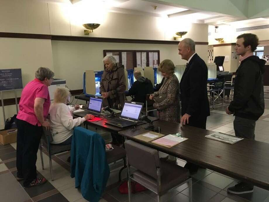 Bob Daiber, center, a candidate for the Democratic governor's nomination, prepares to take advantage of early voting Monday in the Madison County Administration Building. Early voting is available at several locations around the county in advance of the March 20 primary and a complete list of sites and times can be found at http://www.co.madison.il.us/departments/county_clerk/elections/early_voting.php. Photo: Steve Horrell • Shorrell@edwpub.net