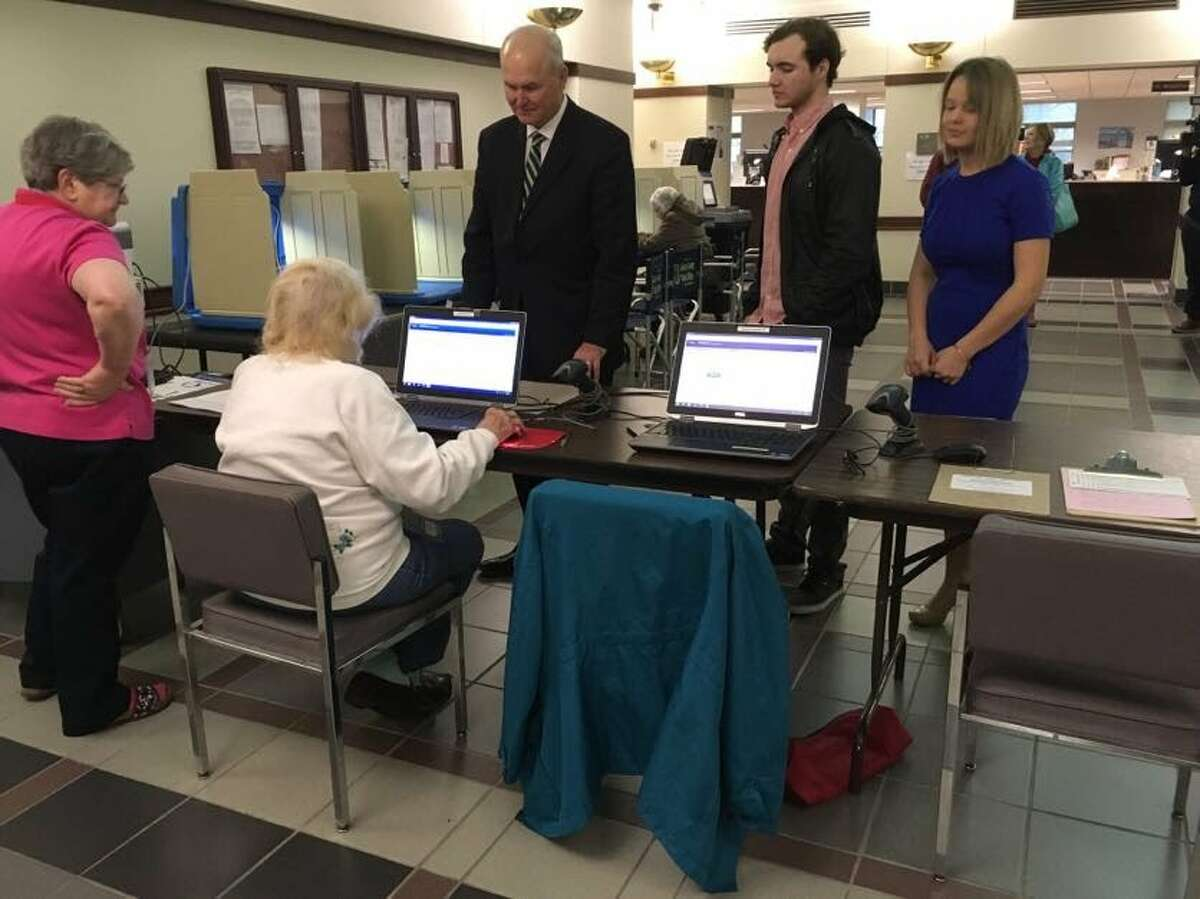 Bob Daiber, center, a candidate for the Democratic governor's nomination, prepares to take advantage of early voting Monday in the Madison County Administration Building. Early voting is available at several locations around the county in advance of the March 20 primary and a complete list of sites and times can be found at http://www.co.madison.il.us/departments/county_clerk/elections/early_voting.php.