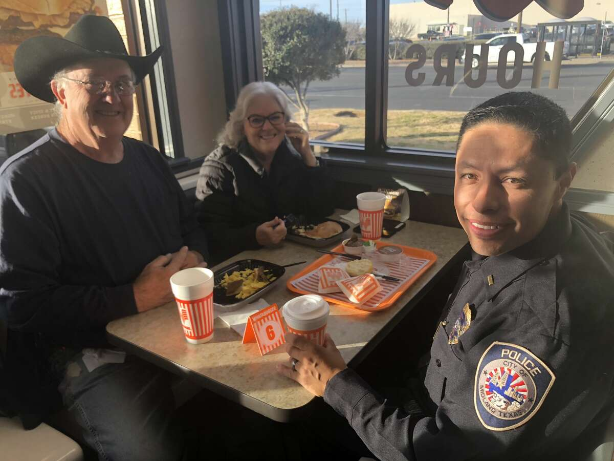 Coffee with a Cop: Dan Johnson, from left, Judy Johnson and Alfredo Grimaldo