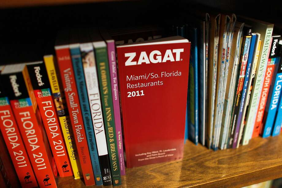 A Zagat book sits on a bookshelf at a store in Miami. When Google bought Zagat in 2011, the idea was that Google could bring the company — which at the time was more than three decades old and famous for its red restaurant guide books — into the modern digital era. Photo: Joe Raedle, Getty