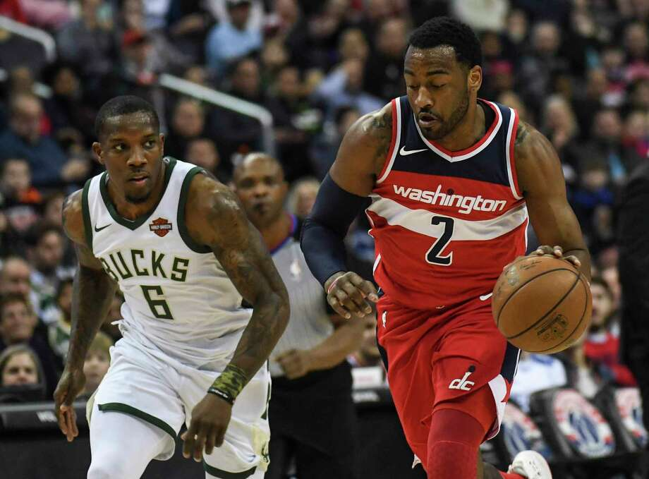Washington Wizards guard John Wall (2) s expected back in the lineup in  about 22aa56b3e