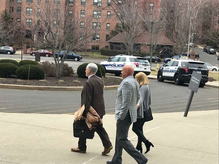 Steve Wilkos leaving the Stamford courthouse where he was appearing for a drunk driving charge. Wilkos is holding hands with a woman and is being led by his attorney Eugene Riccio. Photo: John Nickerson / Staff