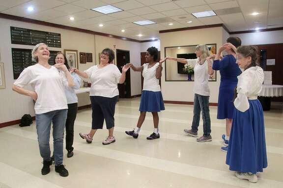 Amira Hemme leads LizAnn Segrera, Anna Lopez, Alesia Stewart, Di Kawalec, Marcy Shae and Patricia Lansdowne doing the Hora Chedera dance.